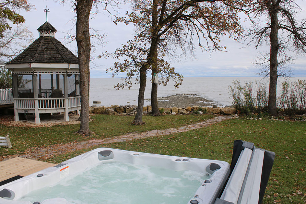 Hot tub with view of Aaron's on the Lake and lake